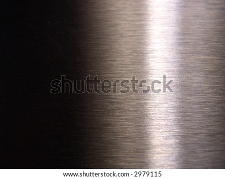 abstract luminous background with horizontal pattern made from burnished steel