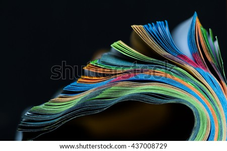 abstract macro close up open book . colorful of open book magazine abstract close up .selective focus blur on black background.  reflection open book abstract blur on black background. - stock photo