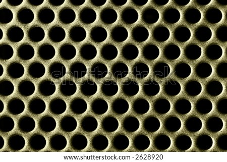 Abstract macro photo of holes on a metal grate
