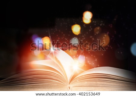 Abstract magic book on wooden background - stock photo