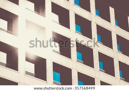 Abstract minimal style architecture background. The reflection of the sun and blue sky mirrored in a modern building window. Retro colors stylization - stock photo