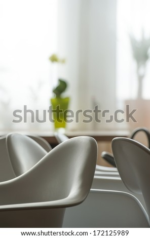 Abstract modern interior of cafe or meeting room with rounded armchairs - stock photo