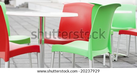 abstract modern outdoor summer cafe. colored chairs. - stock photo