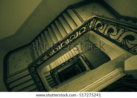 Abstract Mono green tone of spiral staircase background picture
