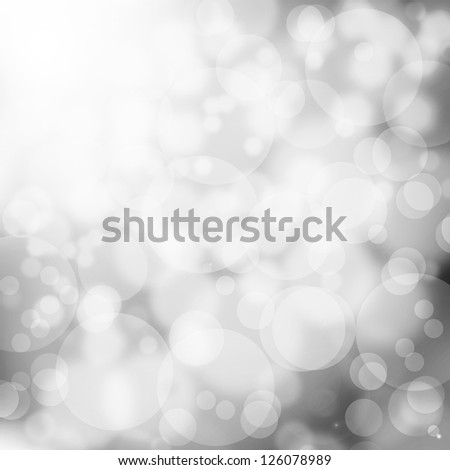 Abstract monochrome lens flare background - bokeh - stock photo
