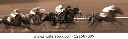 Abstract Motion Blur Horizontal Image of Racing Horses - stock photo