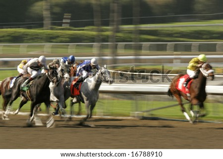 Abstract motion blur of jockey and thoroughbred leading their rivals down the homestretch. Shot at slow shutter speed to enhance motion effect. - stock photo