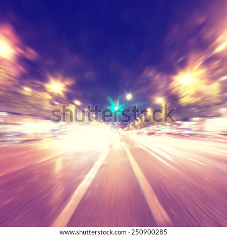 Abstract motion blurred image of night traffic in the city. - stock photo