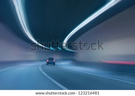 abstract motion blurred in highway tunnel - stock photo