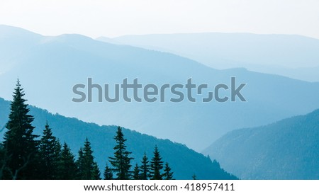 Abstract mountain background - concept of tourism and mountaineering. Layers of ridges in Carpathians Mountains Ukraine at sanrise sky - stock photo