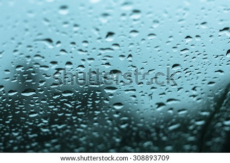 abstract natural rain water drops on glass with vintage filter - stock photo