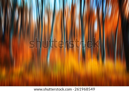 Abstract nature background. Image of trees in an autumn forest. Intentional motion blur - stock photo