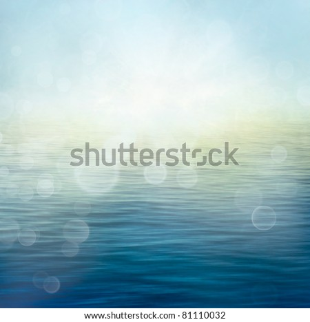Abstract nature summer or spring ocean sea background. Small waves on water surface in motion blur with bokeh lights from sunrise. - stock photo