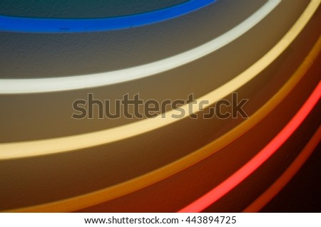 abstract neon light in rainbow colors - stock photo