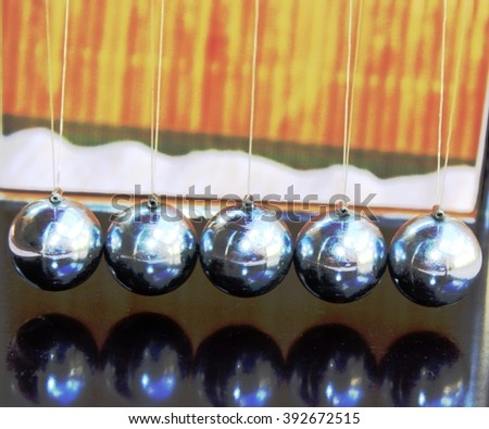 Abstract Newton's balls or perpetual motion balls - stock photo