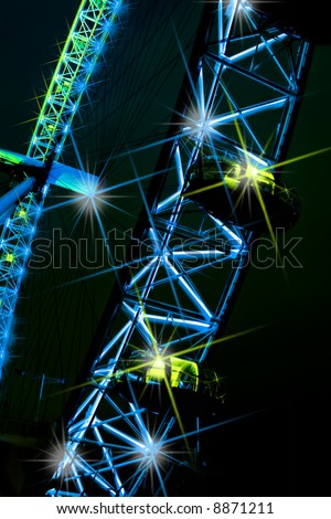 Abstract night view of London Eye - stock photo