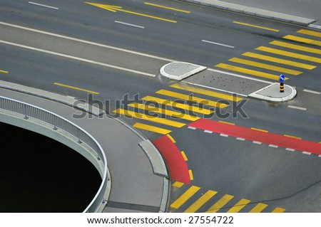 Abstract of a road junction with road markings making an abstract pattern. Suitable for background. Space for text bottom left in the black area. - stock photo