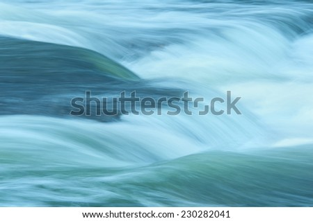 Abstract of a rushing stream. - stock photo
