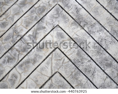 Abstract of arrow sign concrete sidewalk for background - stock photo
