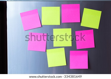 Abstract of Blank paper and stick paper on refrigerator door.