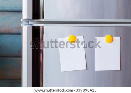 Abstract of Blank paper and stick paper on refrigerator door. - stock photo