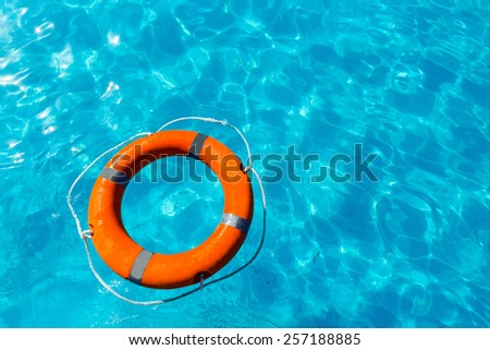 Abstract of blue water background and life preserver - stock photo