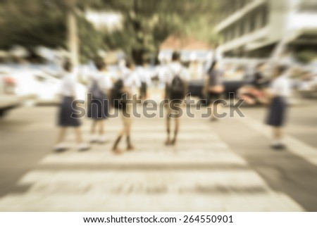 Abstract of blurred schoolchild walk crossing the street - stock photo