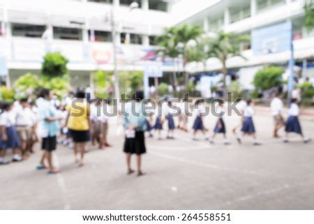 Abstract of blurred schoolchild walking in row in school - stock photo