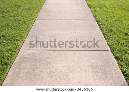 Abstract of concrete sidewalk and grass - stock photo