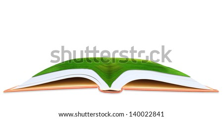 abstract of green grass field on open book - stock photo