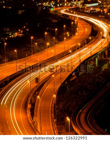 Abstract of light trail at the busy highway - stock photo