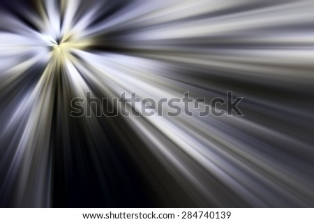 Abstract of mysterious origin, with radially blurred beams of light emitted by a source at upper left, for backgrounds with motifs of origin, revelation, illumination - stock photo
