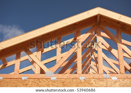 Abstract of New Home Construction Site Framing. - stock photo