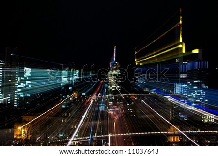 Abstract of nightshot with colorful citylights - stock photo