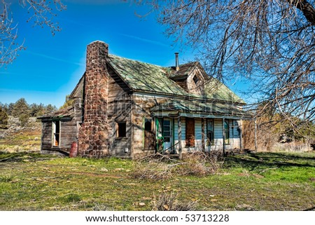 Abstract of old house with trees and blue sky. - stock photo