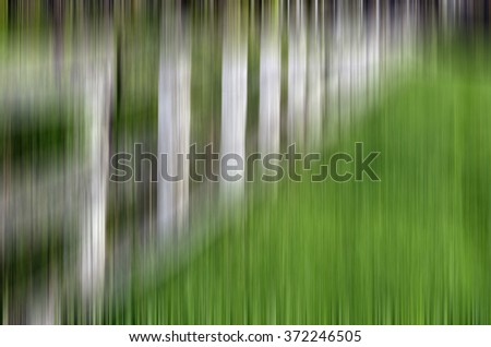 Abstract of receding paddock fence with vertical motion blur, for background or illustration with motifs of ambiguity, sequence, order - stock photo