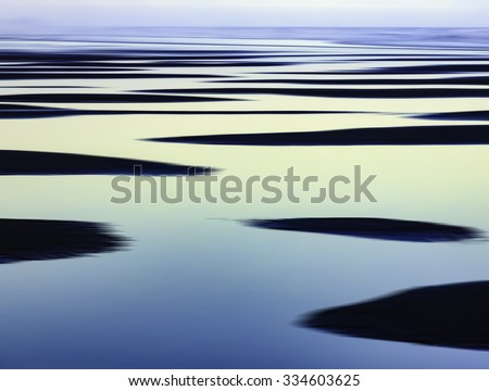 Abstract of sandbars and large tide pools on the Pacific coast of Olympic Peninsula in Washington, USA, for themes of nature, repetition, serenity, the environment (one of a series) - stock photo