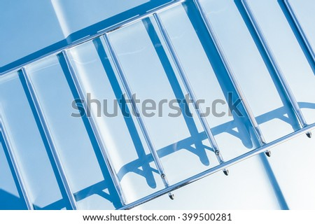 abstract of shadows on a metal frame in strong sunlight - stock photo