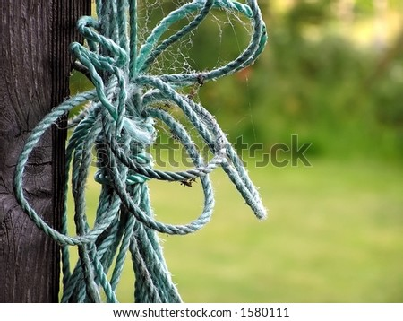 abstract of tangled rope hanging on a hook