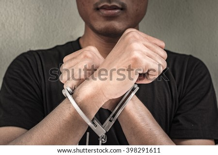 abstract of the man was bound by hand in the shackle of black man out of freedom. background look old or vintage style. (vintage color tone) - stock photo
