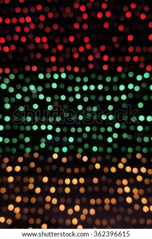 Abstract of Tri-color Bokeh in Red, Green and Orange Christmas Lights Decoration, defocused, for wallpaper and background
