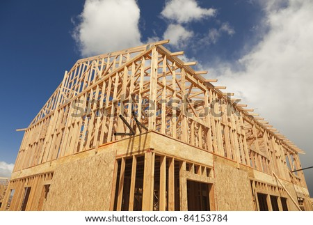 Abstract of Wood Home Framing at Construction Site. - stock photo