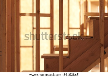 Abstract of Wood Stairs in Home Construction Site. - stock photo