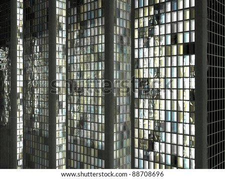 Abstract Office buildings with lighted windows at night - stock photo