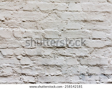 Abstract old brick, painted white, weathered with cracks and scratches. Landscape style. Grungy Concrete Surface. Great background or texture. - stock photo