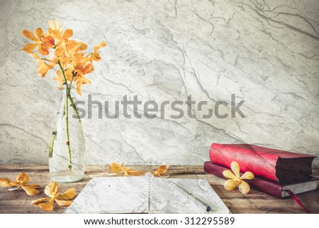Abstract open book with pen on cement textured filtered background. Image of abstract overlay. - stock photo