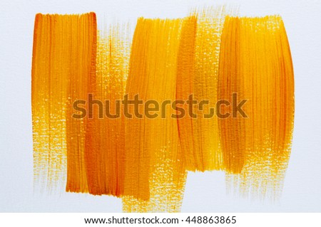 Abstract Orange and yellow Acrylic colors hand paint on white background.