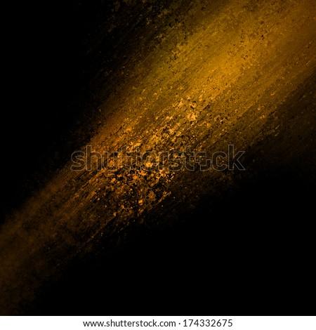 abstract orange copper background design, rough black border with gold streak or stream of bright light on dark contrast black background, unique web design background, elegant brochure layout space - stock photo