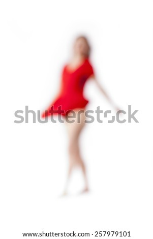 Abstract Out of Focus Image of a Woman in Red Dress - stock photo