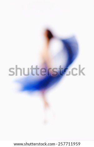 Abstract Out of Focus Image of a Woman with Blue Cloth - stock photo